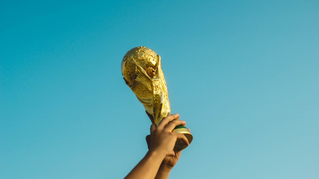 An image of hands holding up a prize.